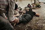 Free Syria Army soldiers crawled through the ground to reach him as others provided fire cover from the sniper above them. © Javier Manzano