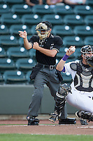 Home plate umpire Tyler Olson makes a strike call during the Carolina League game between the Frederick Keys and the Winston-Salem Dash at BB&T Ballpark on May 24, 2016 in Winston-Salem, North Carolina.  The Keys defeated the Dash 7-1.  (Brian Westerholt/Four Seam Images)