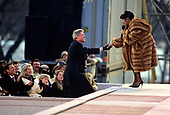 "United States President-elect Bill Clinton shakes hands with entertainer Aretha Franklin at the concert at the Lincoln Memorial that was part of the ""American Reunion"" celebration on the National Mall on January 17, 1993. Looking on and applauding at left are US Vice President-elect Al Gore and his wife, Tipper.<br /> Credit: Howard L. Sachs / CNP"