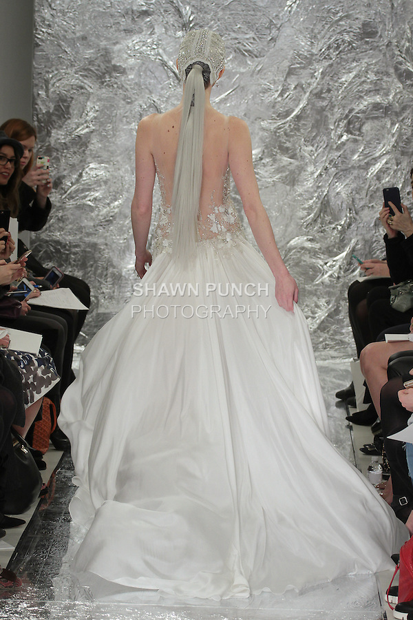Model Caitlin Lyon walks runway in Leelu - a crystal and paillette encrusted bodice with double circle silk habotai skirt, from the Theia Spring 2017 bridal collection by Don O'Neill, during New York Bridal Fashion Week Spring Summer 2017 on April 14, 2016.