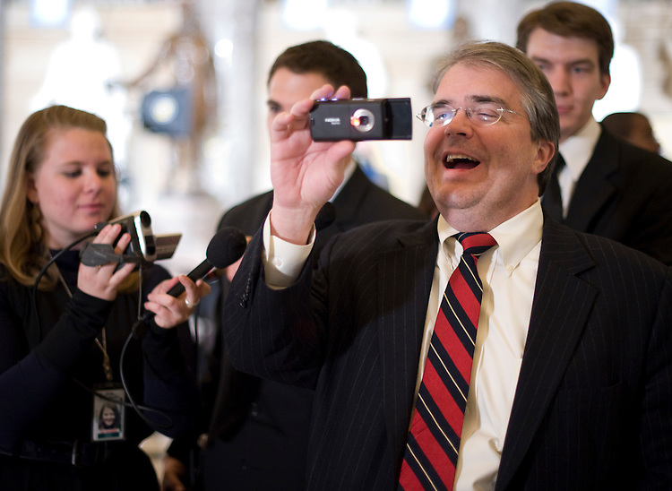 Rep. John Culberson, R-Texas, uses an internet enabled camera to stream live video to qik.com as he films members of the media in Statuary Hall before President Barack Obama's address to the joint session of Congress on Feb. 24, 2009. Culberson was also sending updates to twitter.com from the House Floor during Obama's speech.