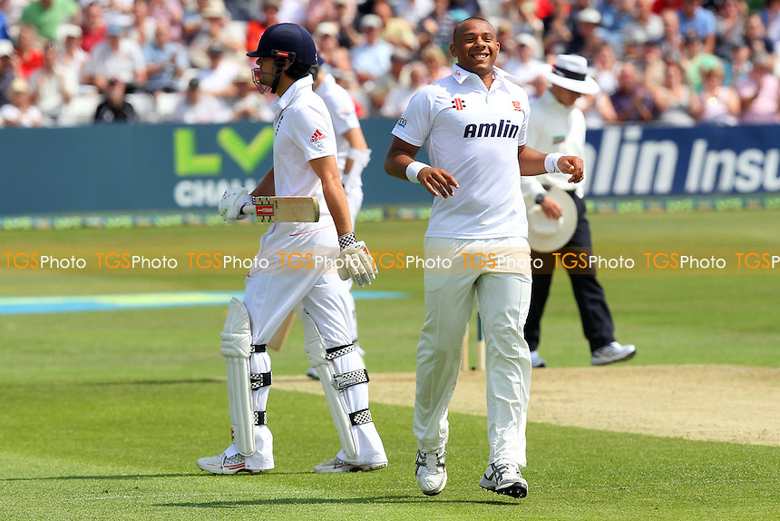 Tymal Mills of Essex celebrates the wicket of England batsman Alastair Cook (L) - Essex CCC vs England - LV Challenge Match at the Essex County Ground, Chelmsford - 30/06/13 - MANDATORY CREDIT: Gavin Ellis/TGSPHOTO - Self billing applies where appropriate - 0845 094 6026 - contact@tgsphoto.co.uk - NO UNPAID USE