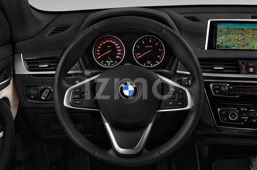 Car pictures of steering wheel view of a 2016 BMW X1 xLine 5 Door Suv Steering Wheel