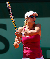 ANASTASIA RODIONOVA (AUS) against NADIA PETROVA (RUS) (26) in the first round of the women's singles. Anastasia Rodionova beat Nadia Petrova 6-7 6-3 6-4 ..Tennis - Grand Slam - French Open - Roland Garros - Paris - Day 2 -  Mon May 23rd 2011..© AMN Images, Barry House, 20-22 Worple Road, London, SW19 4DH, UK..+44 208 947 0100.www.amnimages.photoshelter.com.www.advantagemedianetwork.com.