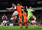 Arsenal's Shkodran Mustafi tussles with Liverpool's Dejan Lovren and Simon Mignolet during the premier league match at the Emirates Stadium, London. Picture date 22nd December 2017. Picture credit should read: David Klein/Sportimage