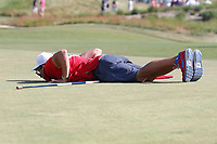The caddie of Patrick Reed (USA) lines up a putt on the 12th hole during the 118th U.S. Open Championship at Shinnecock Hills Golf Club in Southampton, NY, USA. 17th June 2018.<br /> Picture: Golffile | Brian Spurlock<br /> <br /> <br /> All photo usage must carry mandatory copyright credit (&copy; Golffile | Brian Spurlock)