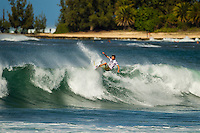 HONOLULU - (Friday, November 16, 2012) Dane Reynolds (USA). -- Pumping Haleiwa delivered the goods at the REEF Hawaiian Pro today with incredible tube rides, aerials and pure power surfing. For the world's top professionals and the surf-stoked fans who flock to the North Shore, this is what the Vans Triple Crown of Surfing is known for: quality surfing in quality waves...Between the high-scoring heat of Australian Tom Whitaker, the mind-altering manoeuvres of Ventura's Dane Reynolds, the tube-riding finesse of Torrey Meister, and the iconic Clash of the Legends between Sunny Garcia (HAW) Mark Occhilupo (AUS), Tom Curren (USA) and Kiapo Jaquais (HAW) everyone went home fired up. Photo: joliphotos.com