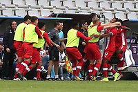 The Canadian substitutes and coaching staff mob Thelonius Bair (No 17) after scoring their opening goal during Japan Under-21 vs Canada Under-21, Tournoi Maurice Revello Football at Stade Parsemain on 3rd June 2018