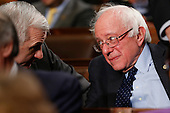 Democratic presidential candidate Sen. Bernie Sanders, I-Vt., talks with Sen. Jack Reid, D- R.I., before the State of the Union address to a joint session of Congress on Capitol Hill in Washington, Tuesday, Jan. 12, 2016. <br /> Credit: Evan Vucci / Pool via CNP