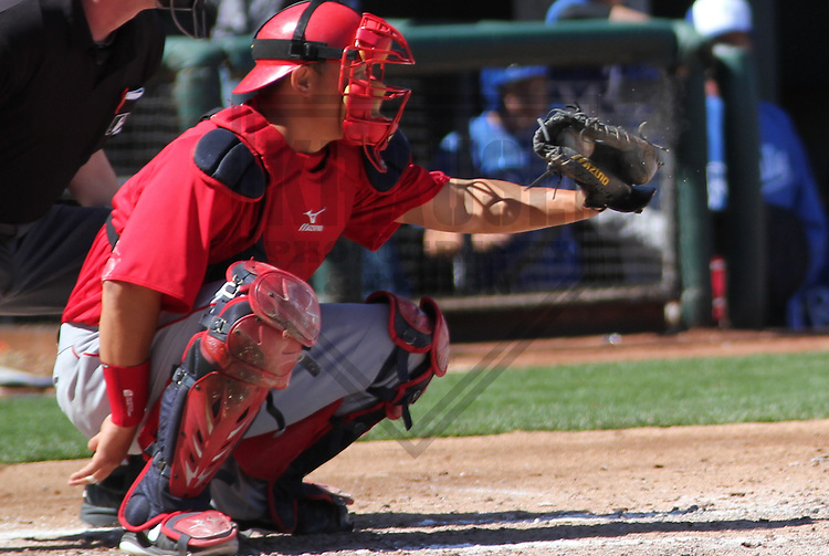 SURPRISE - March 2013: Hank Conger (16) of the Los Angeles Angels of Anaheim during a Spring Training game against the Kansas City Royals on March 10, 2013 at Surprise Stadium in Surprise, Arizona. (Photo by Brad Krause). ..