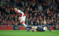 Mesut Ozil of Arsenal crosses the ball during the UEFA Europa League QF 1st leg match between Arsenal and CSKA Moscow  at the Emirates Stadium, London, England on 5 April 2018. Photo by Andrew Aleksiejczuk / PRiME Media Images.