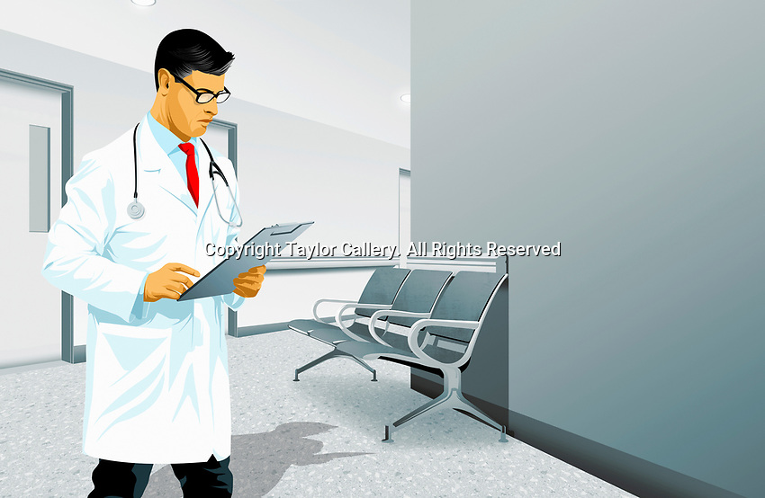 Doctor reading medical record in hospital corridor
