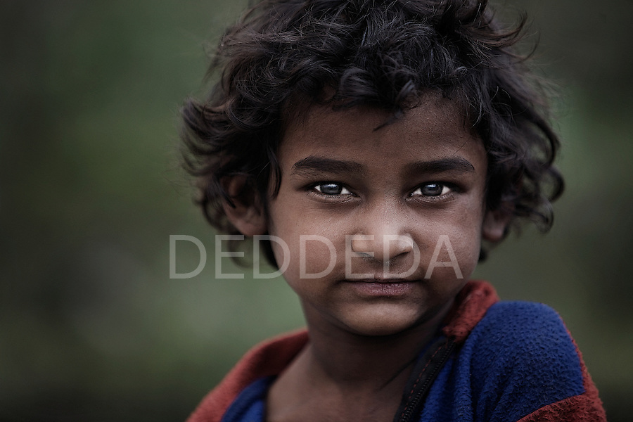 A boy poses for a photograph on the outskirts of Pokhara, Nepal.