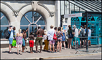 BNPS.co.uk (01202 558833)<br /> Pic: PhilYeomans/BNPS<br /> <br /> Queuing for Harry Ramsden chips.<br /> <br /> The summer heatwave is leading to a 'bumper year' for tourism at Britain's premier seaside resort.<br /> <br /> Over 100,000 people are visiting Bournemouth, Dorset, every weekend and hotels are full to capacity, with restaurants packed and huge queues at ice cream stalls.<br /> <br /> Seafront kiosks are selling out of parasols and sun cream, while one bike hire company has reported a 50 per cent increase in business.