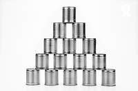 Pyramid of tin cans, on white background (Licence this image exclusively with Getty: http://www.gettyimages.com/detail/102170461 )