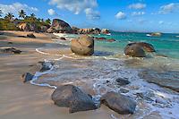 Virgin Gorda, British Virgin Islands, Caribbean<br /> Morning sun dappling the the surf and rock patterns at Little Trunk Bay beach near the Baths
