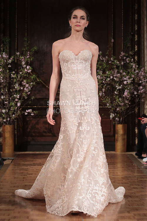 """Model walks runway in an """"Aubrey"""" bridal gown from the Isabelle Armstrong Spring Collection 2017, at Lotte New York Palace Hotel, during New York Bridal Fashion Week Spring Summer 2017 on April 16, 2017."""