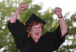 Graduate Rebecca Clemenson pumps her fists at the crowd during the Western Nevada College commencement at the Pony Express Pavilion, in Carson City, Nev., on Monday, May 19, 2014. <br />