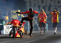 Jun 16, 2017; Bristol, TN, USA; NHRA top fuel nitro Harley Davidson rider Chris Smith jumps off his bike after exploding an engine on fire during qualifying for the Thunder Valley Nationals at Bristol Dragway. Mandatory Credit: Mark J. Rebilas-USA TODAY Sports