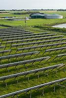 GERMANY Solar field and Biogas plant at Pellworm Northsea island / DEUTSCHLAND , Solarkraftwerk der Eon Hanse und Envitec Biogasanlage mit Blockheizkraftwerk BHKW zur Stromerzeugung und Waermeerzeugung auf Nordseeinsel Pellworm , Vergaerung von Mais und Rinderguelle