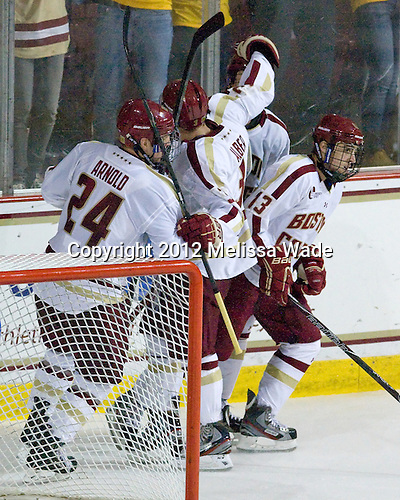 Bill Arnold (BC - 24), Patch Alber (BC - 3), Johnny Gaudreau (BC - 13) - The Boston College Eagles defeated the visiting University of Massachusetts Lowell River Hawks 6-3 on Sunday, October 28, 2012, at Kelley Rink in Conte Forum in Chestnut Hill, Massachusetts.