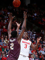 Ohio State Buckeyes guard Shannon Scott (3) is guarded on a three-point shot by Louisiana-Monroe Warhawks forward DeMondre Harvey (2) during Friday's NCAA Division I basketball game at Value City Arena in Columbus on December 27, 2013. Ohio State won the game 71-31. (Barbara J. Perenic/The Columbus Dispatch)