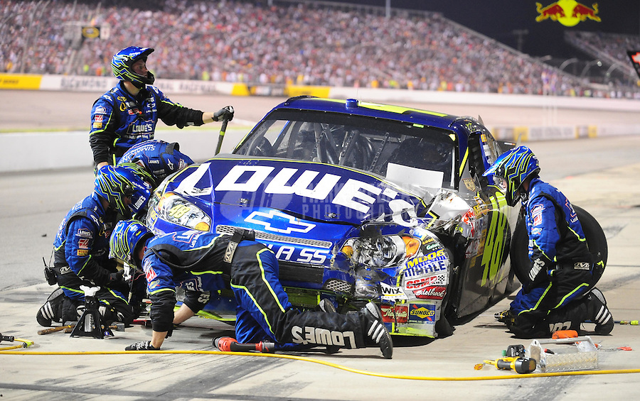 May 3, 2008; Richmond, VA, USA; Crew members survey the damage to the car driven by NASCAR Sprint Cup Series driver Jimmie Johnson after an accident during the Dan Lowry 400 at the Richmond International Raceway. Mandatory Credit: Mark J. Rebilas-US PRESSWIRE