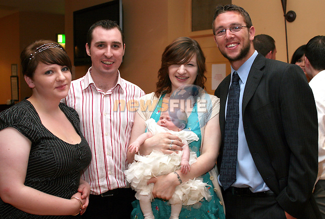 Nessa Gargan (godmother), David Gaynor, Aoife Gargon and John Gaynor (godfather) with baby Paige Gargan at her Christening Party in the Thatch...Photo NEWSFILE/Jenny Matthews.(Photo credit should read Jenny Matthews/NEWSFILE)....This Picture has been sent you under the condtions enclosed by:.Newsfile Ltd..The Studio,.Millmount Abbey,.Drogheda,.Co Meath..Ireland..Tel: +353(0)41-9871240.Fax: +353(0)41-9871260.GSM: +353(0)86-2500958.email: pictures@newsfile.ie.www.newsfile.ie.FTP: 193.120.102.198.