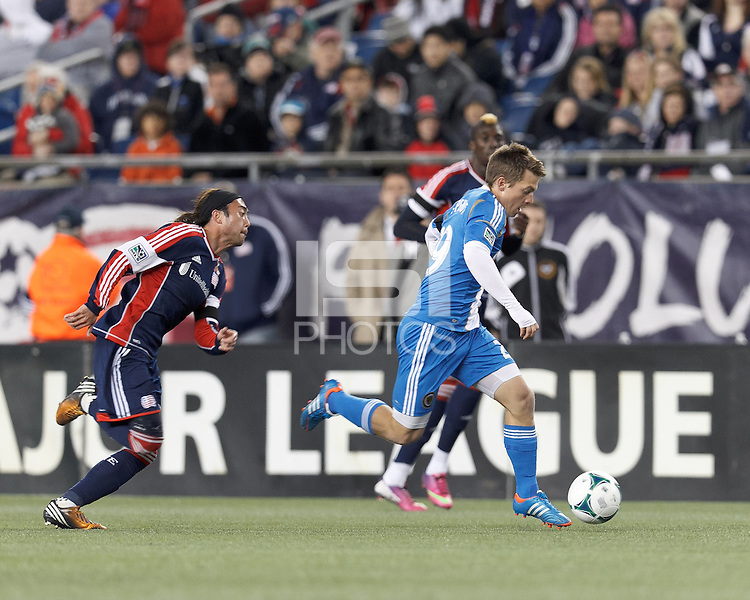 Philadelphia Union substitute forward Antoine Hoppenot (29) on the attack as New England Revolution midfielder Lee Nguyen (24) closes.In a Major League Soccer (MLS) match, the New England Revolution (blue/red) defeated Philadelphia Union (blue/white), 2-0, at Gillette Stadium on April 27, 2013.