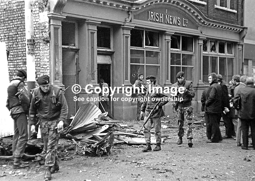 British soldiers at scene of explosion at Irish News offices, Upper Donegall Street, Belfast,  N Ireland. Damage was minor and there were no serious injuries. The attack was blamed on the Provisional IRA who it is believed were unhappy with the newspaper's editorial stance. 17th April 1973. 197304170205a.<br /> <br /> Copyright Image from Victor Patterson, 54 Dorchester Park, <br /> Belfast, UK, BT9 6RJ<br /> <br /> t1: +44 28 9066 1296 (from Rep of Ireland 048 9066 1296)<br /> t2: +44 28 9002 2446 (from Rep of Ireland 048 9002 2446)<br /> m: +44 7802 353836<br /> <br /> e1: victorpatterson@me.com<br /> e2: victorpatterson@gmail.com<br /> www.victorpatterson.com<br /> <br /> Please see my Terms and Conditions of Use at www.victorpatterson.com. It is IMPORTANT that you familiarise yourself with them.<br /> <br /> Images used on the Internet must be visibly watermarked i.e. &copy; Victor Patterson<br /> within the body of the image and copyright metadata must not be deleted. Images <br /> used on the Internet have a size restriction of 4kbs and will be chargeable at current<br />  NUJ rates unless agreed otherwise.<br /> <br /> This image is only available for the use of the download recipient i.e. television station, newspaper, magazine, book publisher, etc, and must not be passed on to any third <br /> party. It is also downloaded on condition that each and every usage is notified within 7 days to victorpatterson@me.com<br /> <br /> The right of Victor Patterson to be identified as the author is asserted in accordance with The Copyright Designs And Patents Act (1988).