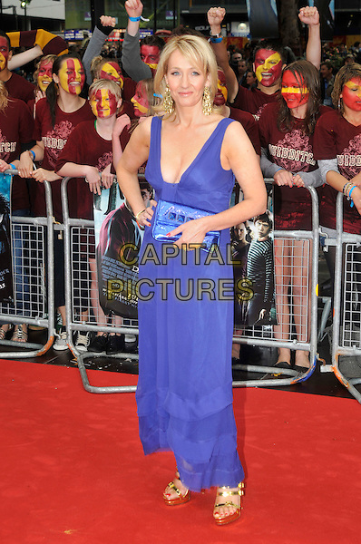 "JK ROWLING aka Joanne ""Jo"" Murray.Arriving at the World Premiere of ""Harry Potter and the Half-Blood Prince"" at the Odeon cinema, Leicester Square, London, England, UK, July 7th 2009..Half Blood full length blue long maxi dress clutch bag gold sandals shiny metallic platform  strappy cleavage hand on hip heels purple j.k..CAP/PL.©Phil Loftus/Capital Pictures"