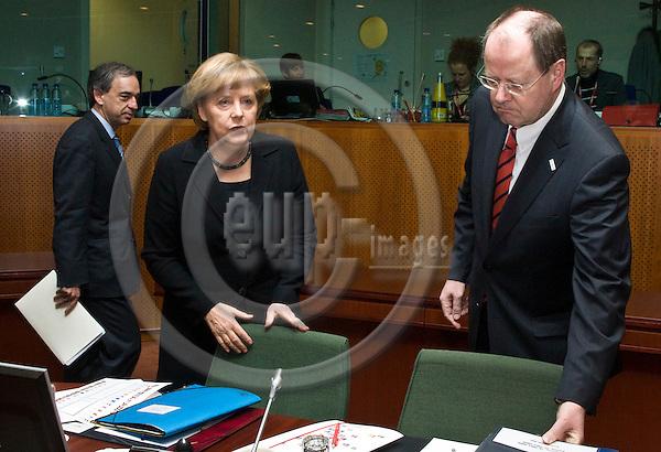 BRUSSELS - BELGIUM - 19 MARCH 2009 -- European Summit under the Presidency of the Czech Republic. --  Angela MERKEL (Ce), Federal Chancellor of Germany with  Peer STEINBRÜCK (Steinbrueck, Steinbruck) Finance Minister of Germany. Charilaos STAVRAKIS, Finance Minster for Cyprus on the left. -- PHOTO: Juha ROININEN / EUP-IMAGES
