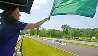 Green flag waves at start of Memorial Day Classic Grand-Am Roles Series race, Lime Rock Park, Lakeville, CT, May 20, 2011.  (Photo by Brian Cleary/www.bcpix.com)