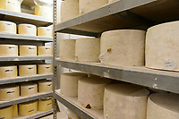 Stored cheese at the Cheddar Gorge Cheese Co,. Cheddar Gorge, Cheddar, UK, October 16, 2017. Spectacular Cheddar Gorge features the highest inland cliffs in the UK. The nearby village of Cheddar is also the birthplace of the eponymous cheese.
