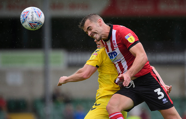 Lincoln City's Harry Toffolo vies for possession with Fleetwood Town's Josh Morris<br /> <br /> Photographer Chris Vaughan/CameraSport<br /> <br /> The EFL Sky Bet League One - Lincoln City v Fleetwood Town - Saturday 31st August 2019 - Sincil Bank - Lincoln<br /> <br /> World Copyright © 2019 CameraSport. All rights reserved. 43 Linden Ave. Countesthorpe. Leicester. England. LE8 5PG - Tel: +44 (0) 116 277 4147 - admin@camerasport.com - www.camerasport.com