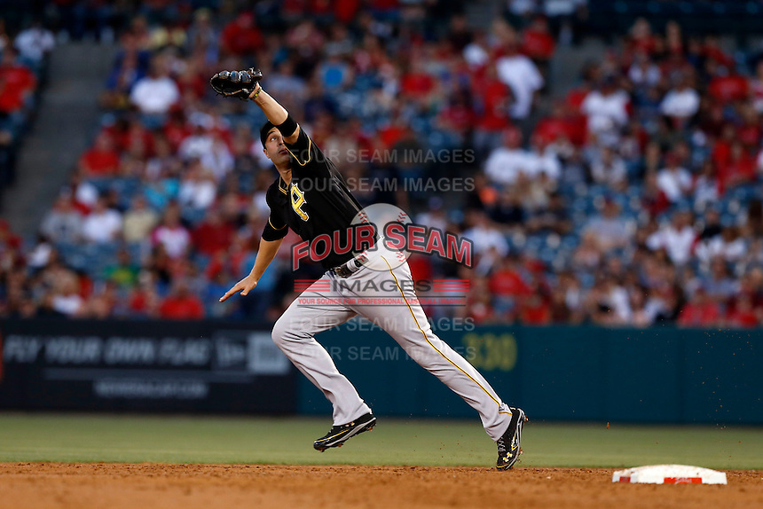 Neil Walker #18 of the Pittsburgh Pirates during a game against the Los Angeles Angels at Angel Stadium on June 21, 2013 in Anaheim, California. (Larry Goren/Four Seam Images)
