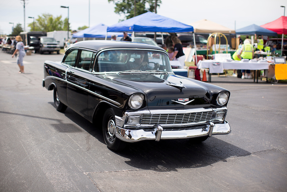 Pete Lahm drives his 1956 Chevrolet Delray 2-Door Sedan through the parking lot after show and shine judging at the 4th State Representative Chevy Show on Saturday, July 2, 2016, in Fort Wayne, Indiana. (Photo by James Brosher)