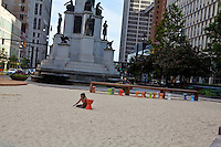 A young girl plays in the sand of Campus Martius park in downtown Detroit (Mi) Saturday June 8, 2013.