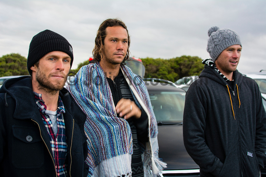 Bells Beach, Torquay Victoria, Australia. (Saturday April 19, 2014) Jarrod Howse (AUS), Jordy Smith (ZAF) and Adrian Ace Buchan (AUS) check the surf.–  The 2014  Rip Curl Pro at Bells Beach kicked off today with the men's Round 1 and part of Round 2 in a building south west swell. The surf was in the 4'-6' range for most of the day and the wind stayed light and offshore till mid afternoon when it switched to onshore. The contest was called off after Heat 2 of the Round 2 because of the onshore conditions .Photo: joliphotos.com