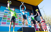 Picture by SWpix.com - 06/05/2018 - Cycling - 2018 Tour de Yorkshire - Stage 4: Halifax to Leeds - Yorkshire, England - BMC's Greg Van Avermaet holds the Tour de Yorkshire trophy aloft with second place Eusadi Basque Country Murias' Eduard Prades Reverter & third place Dimension Data's Serge Pauwels.