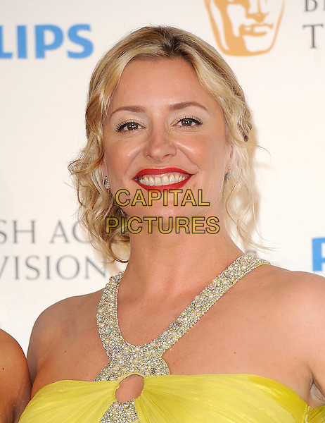 LAURIE BRETT .in the press room at the Philips British Academy Television Awards (BAFTA) at the London Palladium in London, England, June 6th, 2010..BAFTAs TV portrait headshot red lipstick smiling yellow make-up beaded straps .CAP/BEL.©Tom Belcher/Capital Pictures.