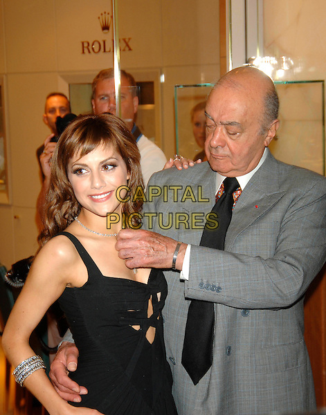 BRITTANY MURPHY & MOHAMED AL FAYED.Opens the Harrods Summer Sale, .Knightsbridge, London, June 27th 2005..half length jewellery necklace bracelets.Ref: PL.www.capitalpictures.com.sales@capitalpictures.com.©Capital Pictures