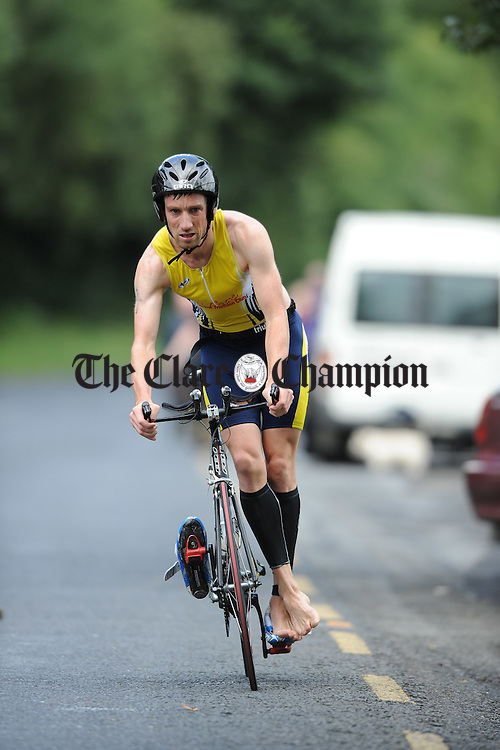 Rushing home for the changeover from bike to foot during the Brian Boru Sprint Triathlon at Two-Mile-Gate,  Killaloe. Photograph by John Kelly.