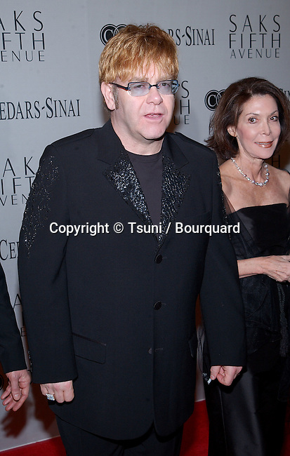 Elton Jones arriving at the benefit for the Cedars Sinai research for Women's Cancer at the Regent Beverly Wilshire in Los Angeles. March 26, 2002.             -            JohnElton_sir_04.jpg