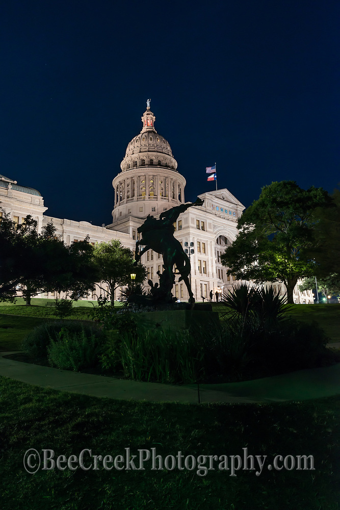This cowboy and horse statue on the lawn at the Texas Capitol in downtown Austin is symbolic of the Texas cowboys.  We decided to silouette this cowboy statue against the capitol at night in a verticle format.