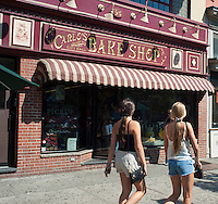 "Carlo's Bake Shop in Hoboken, NJ is seen on Saturday, July 21, 2012. Th family run bakery featuring baker Buddy Valastro, his family and crew, is a popular international syndicated television program called ""Cake Boss"". Fans of the program make a pilgrimage to the bakery often waiting hours on line to enter the crowded store to bask amongst thse sweet treats. (© Richard B. Levine)"