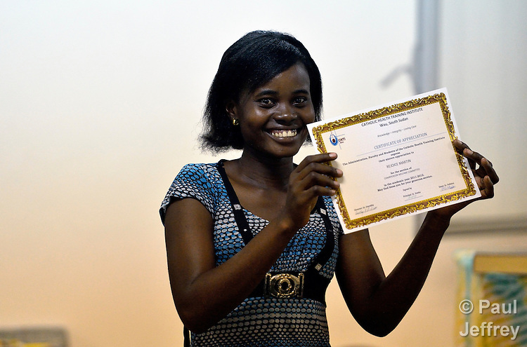 A woman student proudly displays a certificate she received during an assembly in the Catholic Health Training Institute in Wau, South Sudan. The Institute trains nurses and midwives in the newly independent country, and is coordinated by Solidarity with South Sudan, an international consortium of more than 200 religious congregations that trains teachers, health workers and pastoral personnel in several locations throughout South Sudan.
