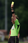 20 June 2009: Kari Seitz, WPS referee, issues a yellow card warning.  Saint Louis Athletica were defeated by the visiting Washington Freedom  0-1 in a regular season Women's Professional Soccer game at AB Soccer Park, in Fenton, MO.