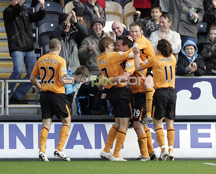 PICTURE BY VAUGHN RIDLEY/SWPIX.COM - Football - Barclays Premier League - Hull City v Wigan - KC Stadium, Hull, England - 03/10/09...Copyright - Simon Wilkinson - 07811267706...Hull's Jan Vennegoor of Hesselink (29) celebrates his goal with teammates.