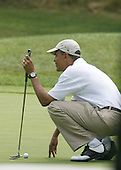 Martha's Vineyard, MA - August 25, 2009 -- United States President Barack Obama lines up a putt during a round of golf at Mink Meadows GC, Vineyard Heaven, Massachusetts on Tuesday, August 25, 2009..Credit: Michael J. Maloney - Pool via CNP